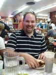 Josh enjoying a pastrami sandwich at Katz's Deli in NYC